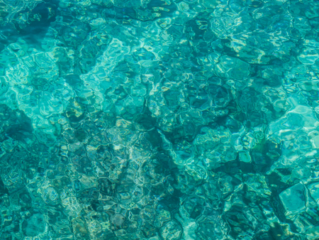 Abstract image of clear turquoise sea water, filling the picture. Stock Photo