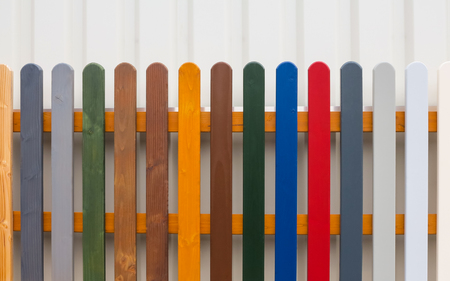 Colorful fence with wooden slats in different colors. photo