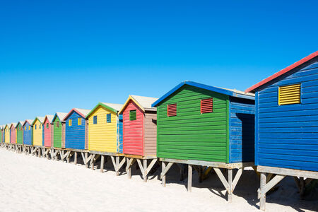 huts: Colorful bathhouses at Muizenberg, Cape Town, South Africa, standing in a row. Stock Photo