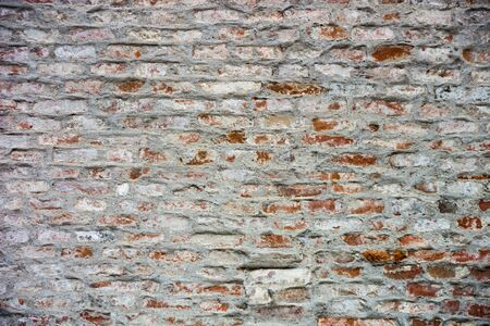 Close-up of a weathered brick wall.