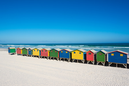cape town: Colorful bathhouses at Muizenberg, Cape Town, South Africa, standing in a row. Stock Photo