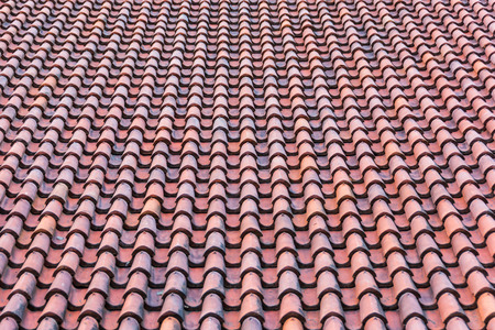 Homogeneous surface of red weathered roof tiles. Stock Photo