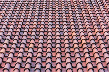 homogeneous: Homogeneous surface of red weathered roof tiles. Stock Photo