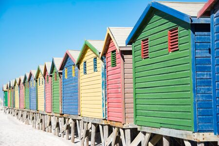 Colorful bathhouses at Muizenberg, Cape Town, South Africa, standing in a row. Stock Photo