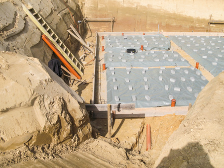 Preparing a concrete base in an excavation for a house, detail Stock Photo
