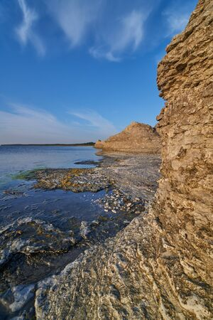 sedimentation: Byrums Raukar, Oeland, Sweden, spectacular tower formation created by limestone eroded of water, sunny evening with blue sky