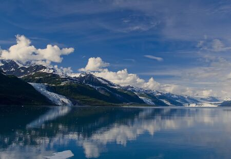 frigid: College Fjord is a fjord located in the northern sector of Prince William Sound in the U.S. state of Alaska. The fjord contains five tidewater glaciers (glaciers that terminate in water), five large valley glaciers, and dozens of smaller glaciers, most na Stock Photo