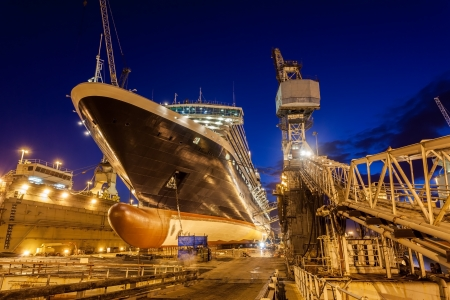 commercial docks: Ship inside a dry dock being repaired