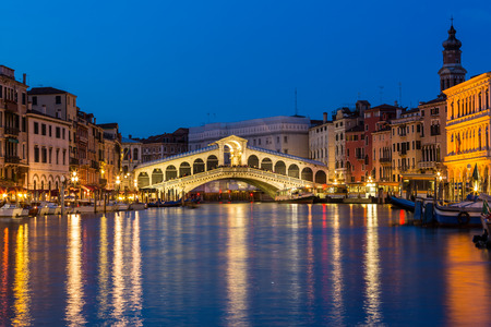 canals: Night shot of the Rialto bridge, Venice Italy Stock Photo