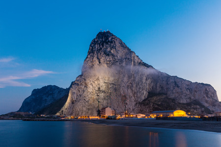 The rock of Gibraltar seen from the bay-side at dusk