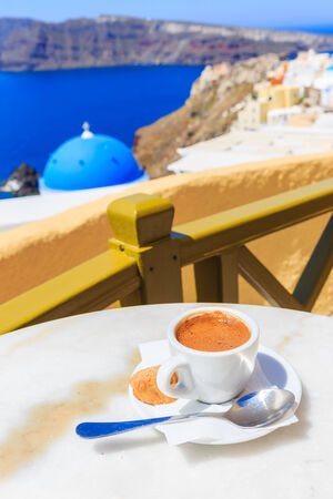 Coffee at Oia village, Santorini Greece photo