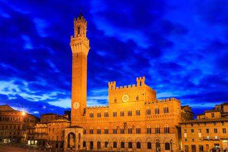 siena: Torre del Mangia and Palazzo Pubblico at twilight. Siena, Italy