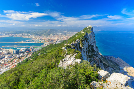 gibraltar: Gibraltar Rock view from above, on the left Gibraltar town and bay, La Linea town in Spain at the far end, Mediterranean Sea on the right.