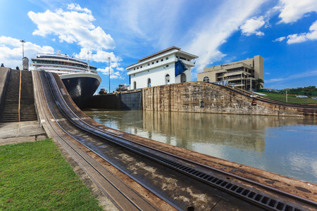 Ship exits locks at the Panama Canal towards the Pacific Ocean.