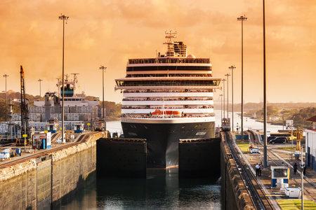 Panama Canal - April 20, 2011: Cruise ship enters the Gatun locks in the Panama Canal. Early morning. Panama.