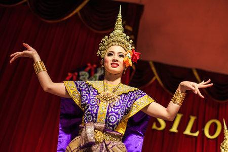 wat bowon: Exotic Thai Classical Dancer. Ancient dancing art, Khon. Ruen Thep Thai Theatre.  Bangkok, Thailand Editorial