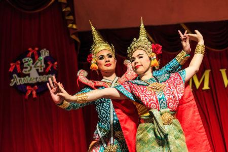 wat bowon: Exotic Thai Classical Dancers. Ancient dancing art, Khon. Ruen Thep Thai Theatre.  Bangkok, Thailand Editorial