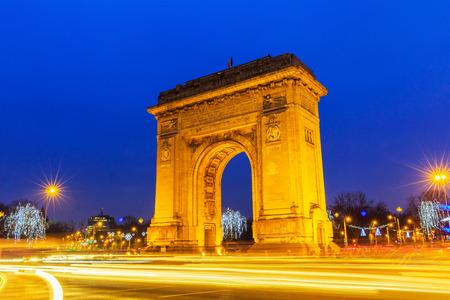 bucuresti: Arc de triumph Bucharest, twilight view Stock Photo