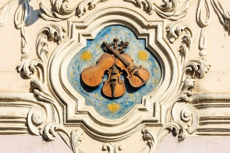 violins: Three Little Violins.  Sign at the house in Mala Strana in Prague, Czech Republic.