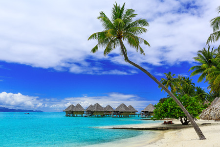 bungalows: Over-water bungalows of luxury tropical resort, Bora Bora island, near Tahiti, French Polynesia, Pacific ocean Stock Photo