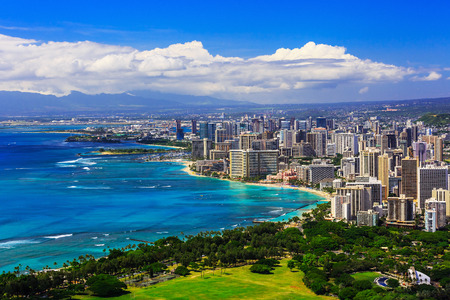 view on sea: Skyline of Honolulu, Hawaii and the surrounding area including the hotels and buildings on Waikiki Beach