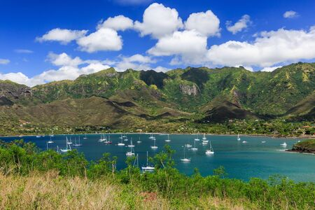 barrier island: Bay of Taiohae on the island of Nuku Hiva, Marquesas Islands Stock Photo