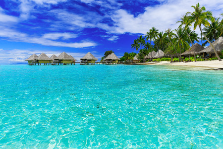 Over-water bungalows of luxury tropical resort, Bora Bora island, near Tahiti, French Polynesia, Pacific ocean Stock Photo
