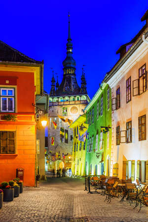 Sighisoara, Transylvania, Romania. Medieval street with Clock Tower Stock Photo