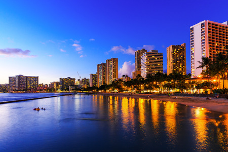hawaii sunset: View of Honolulu and Waikiki Beach at night; Hawaii, USA