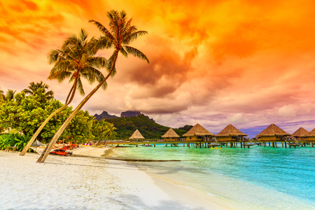 bora: Bora Bora, French Polynesia. Otemanu mountain, beach and palm trees. Stock Photo