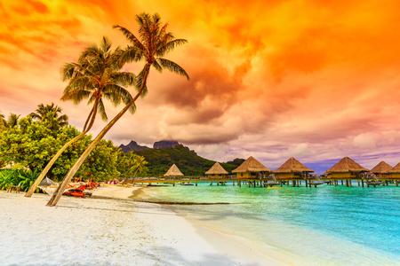 Bora Bora, French Polynesia. Otemanu mountain, beach and palm trees. Foto de archivo
