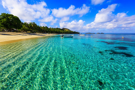 Dravuni Island, Fiji. Crystal clear waters on the shores of Dravuni Island. Stock Photo