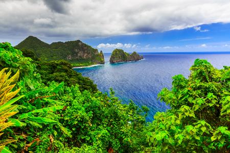american background: Pago Pago, American Samoa. Camel Rock near the village of Laulii. Stock Photo