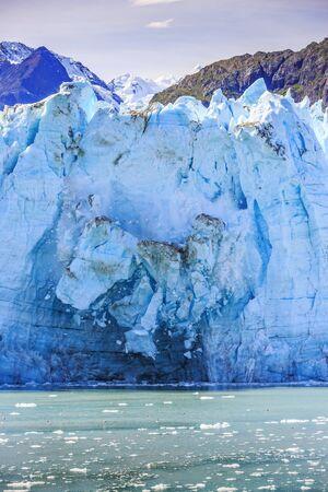 calving: Glacier Bay, Alaska. Ice calving at Margerie Glacier in Glacier Bay National Park Stock Photo
