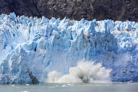 calving: Glacier Bay, Alaska. Ice calving at Margerie Glacier in Glacier Bay National Park Stock Photo