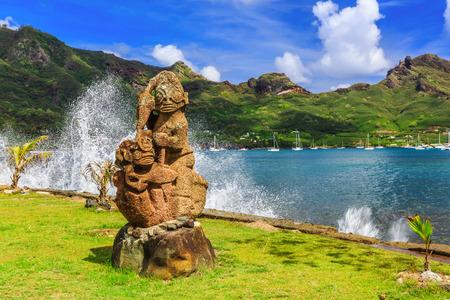 barrier island: Nuku Hiva, Marquesas Islands. Tiki on the bay of Nuku Hiva.