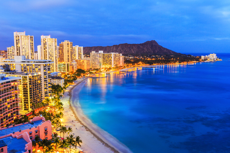 bay: Honolulu, Hawaii. Skyline of Honolulu, Diamond Head volcano including the hotels and buildings on Waikiki Beach.