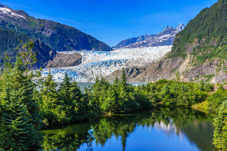 Juneau, Alaska. Mendenhall Glacier Viewpoint with reflection in the lake. Stock Photo