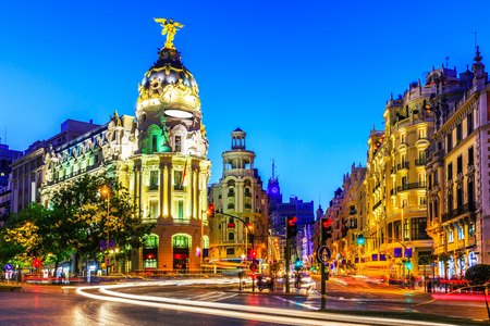 building color: Madrid, Spain. Gran Via, main shopping street at dusk.