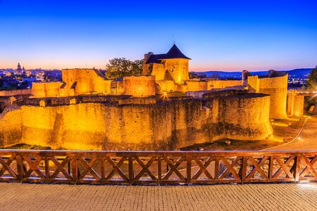 Moldavia, Romania. Ruins of Suceava fortress at twilight.