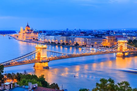 obuda: Budapest, Hungary. The chain bridge over river Danube and famous building of Parliament. Stock Photo