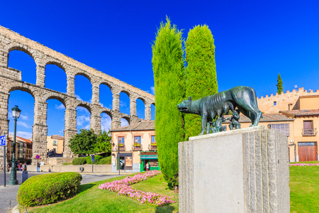 segovia: Segovia, Spain. She wolf with Romulus and Remus and the roman aqueducy. Stock Photo