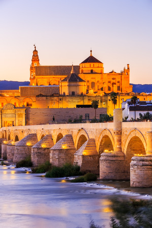 Cordoba, Spain. Roman Bridge and Mezquita (Great Mosque) Cathedral on the Guadalquivir River. Stock Photo