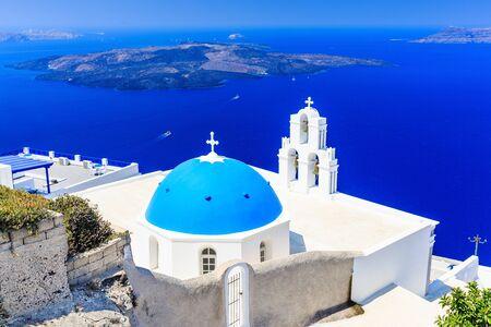 fira: Santorini, Greece. Blue dome Church St. Spirou in Firostefani village.