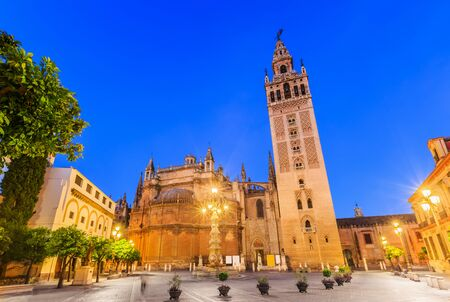 Seville, Spain. Cathedral of Saint Mary of the See with the Giralda bell tower.