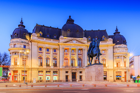 Bucharest, Romania. The Central University Library and statue of King Carol I of Romania