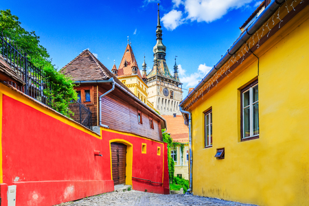 Sighisoara, Romania. Medieval street with Clock Tower in Transylvania. Imagens