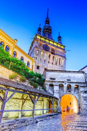 Sighisoara, Romania. Medieval street with Clock Tower in Transylvania. Editorial