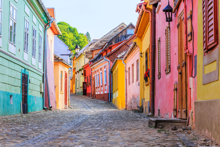 Sighisoara, Romania. Medieval street with houses in Transylvania.