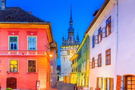Sighisoara, Romania. Medieval street with Clock Tower in Transylvania. Stock Photo